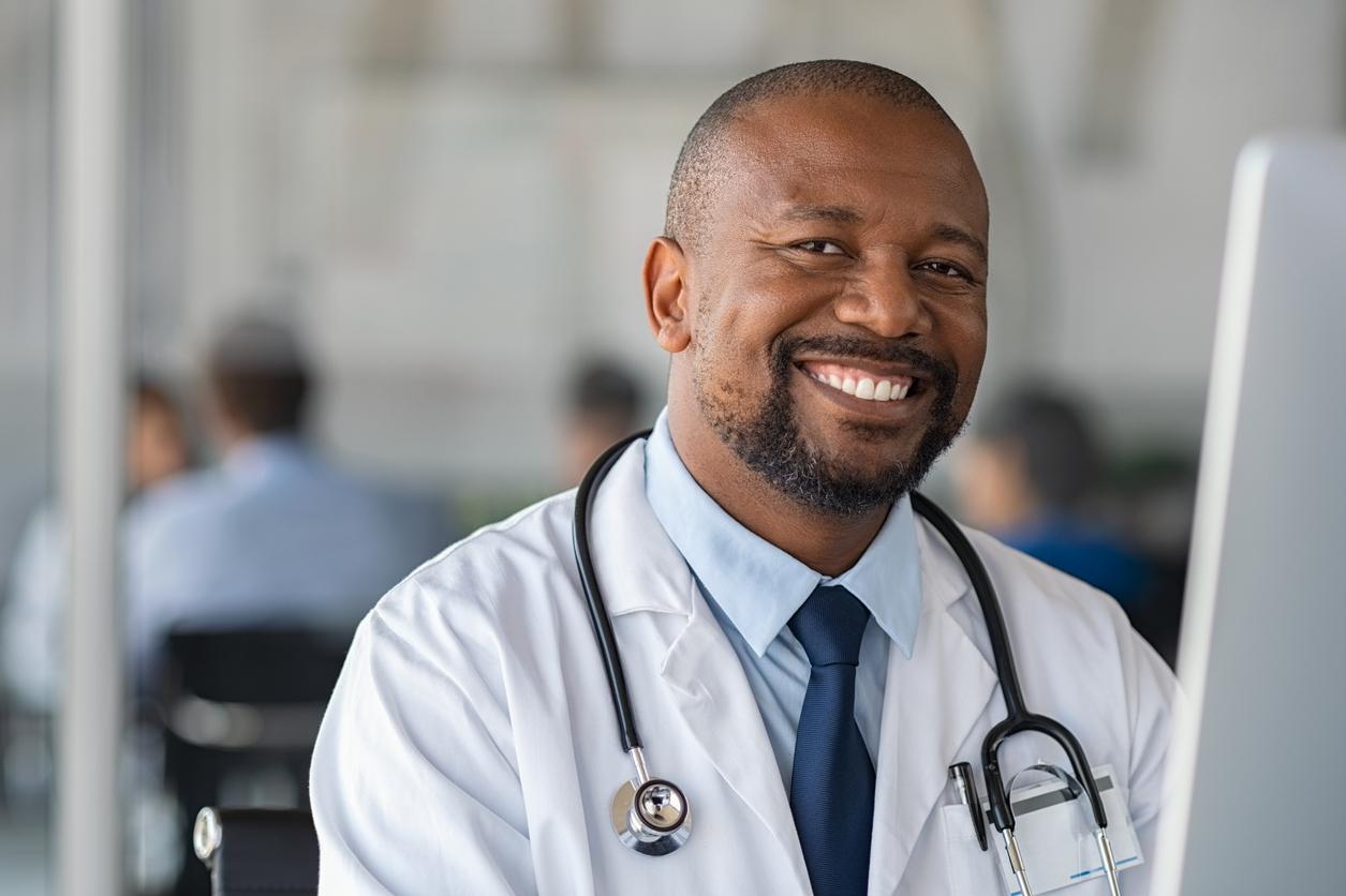 Black male doctor smiling