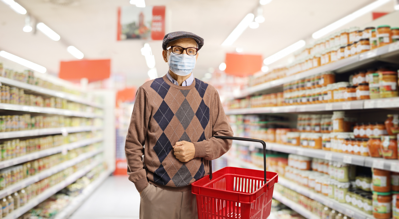 Senior wearing mask in grocery store