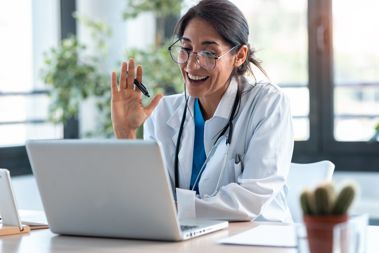 Doctor speaking with patient over computer
